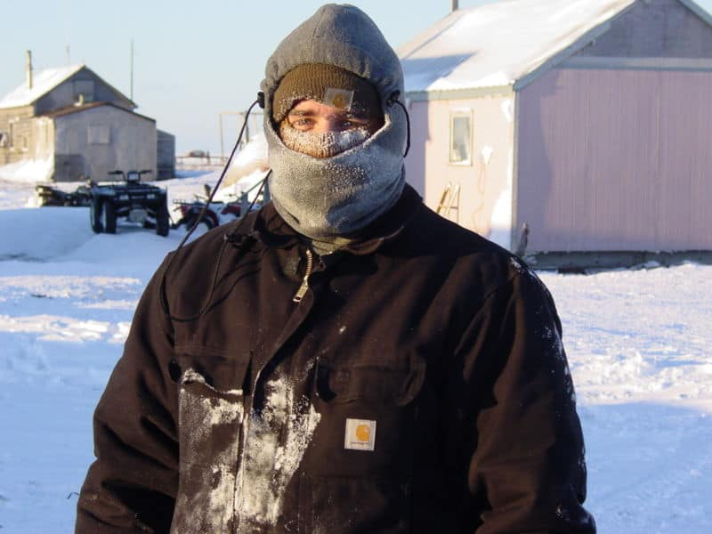 a man standing outside in heavy winter clothing