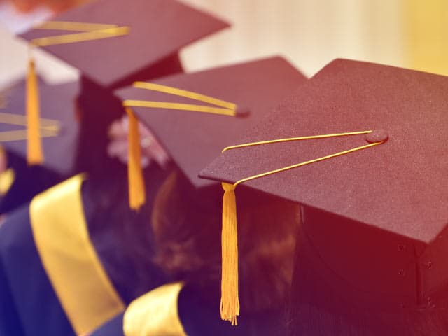 Students wearing graduation caps